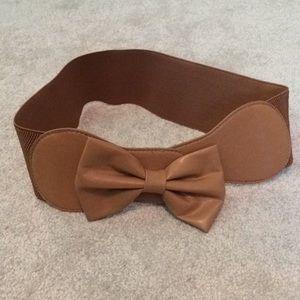 Brown bow belt